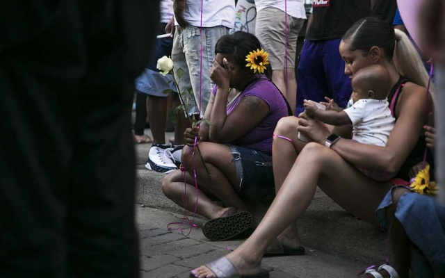 Mourners at a vigil for victims of the mass shooting in Dayton, Ohio, Aug 4, 2019. The one common thread connecting many of the men who carry out mass shootings — other than access to powerful firearms — is a history of hating women, assaulting wives, girlfriends and female family members, or sharing misogynistic views online. The New York Times