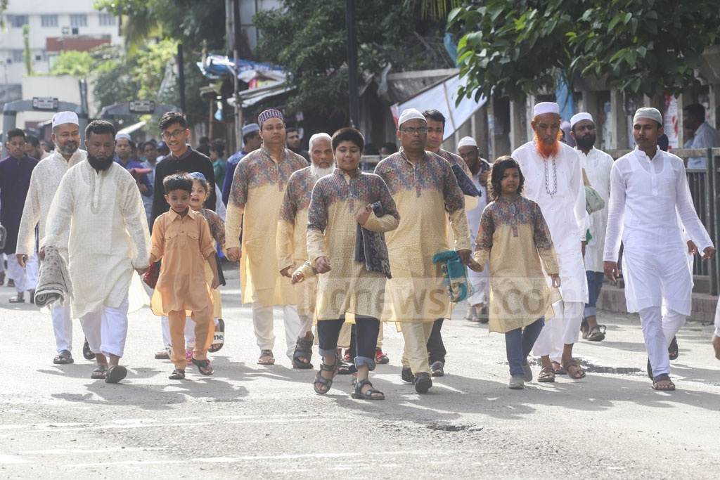 Muslims walking to the National Eidgah ground in Dhaka on Monday morning to attend Bangladesh's main Eid-ul-Azha congregation. Photo: Abdullah Al Momin