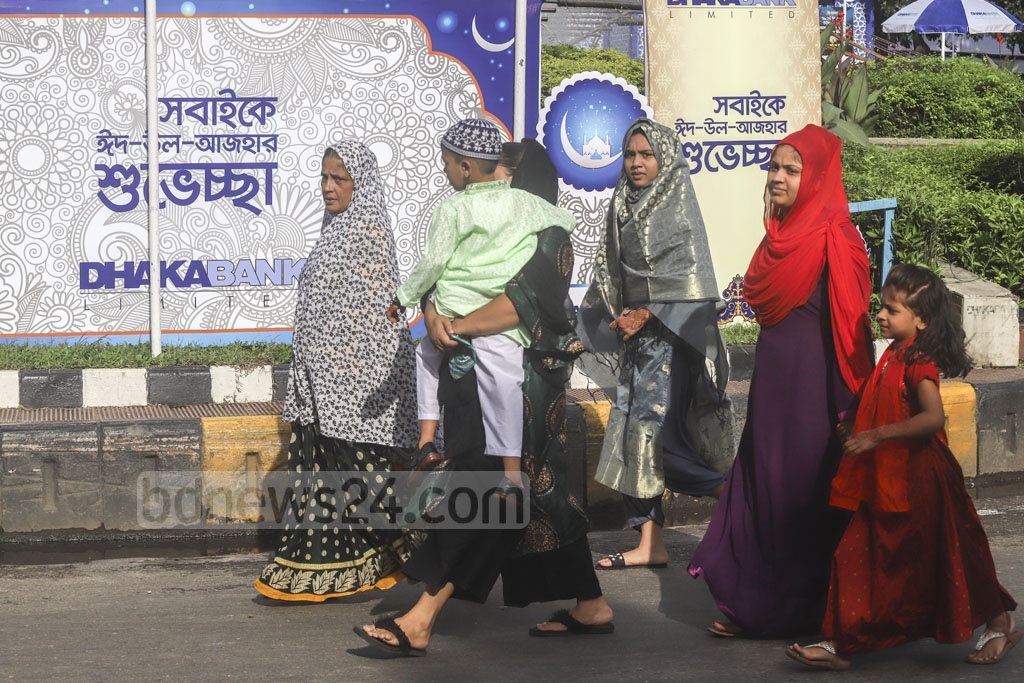 Muslim women and girls walking to the National Eidgah ground in Dhaka on Monday morning to join in Bangladesh's main Eid-ul-Azha congregation. Photo: Abdullah Al Momin