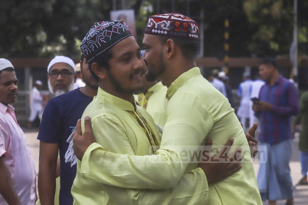 Muslims hugging and greeting each other after offering prayers at Eid-ul-Azha congregation at the National Eidgah ground on Monday. Photo: Abdullah Al Momin