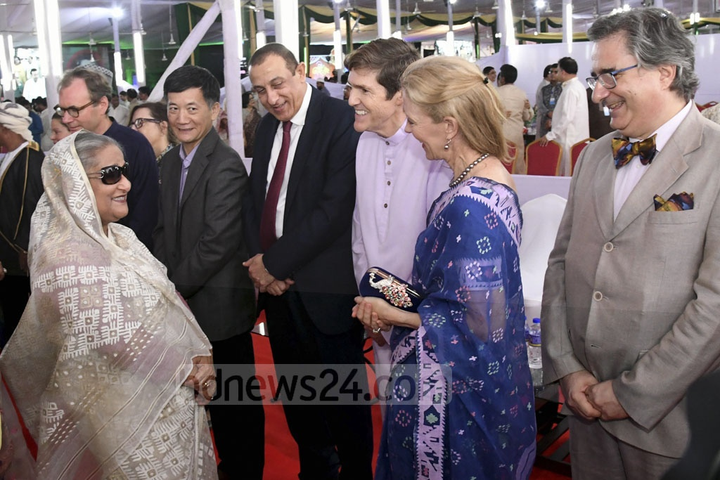 Prime Minister Sheikh Hasina exchanging Eid-ul-Azha greetings with leaders and activists of the ruling Awami League, foreign diplomats, top court judges and people from all walks of life at the Ganabhaban on Monday. Photo: PID