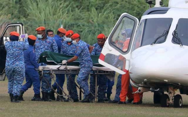 A body believed to be 15-year-old Irish girl Nora Anne Quoirin who went missing is brought out of a helicopter in Seremban, Malaysia, August 13, 2019. Reuters