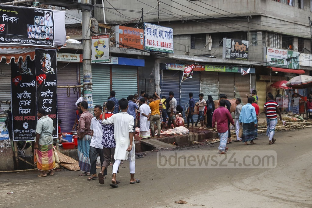 Eid cattle slaughter continues in many parts of Dhaka on the second day of Eid-ul-Azha. The photo was taken from old Dhaka's Nawabpur on Tuesday. Photo: Abdullah Al Momin