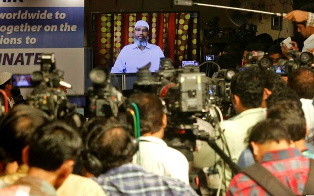 Zakir Naik, an Indian Islamic preacher and founder of Islamic Research Foundation, speaks to the media via a video conference in Mumbai, India, Jul 15, 2016. REUTERS/Shailesh Andrade