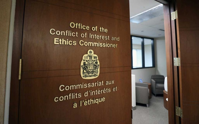 FILE PHOTO: A sign is pictured outside the Office of the Conflict of Interest and Ethics Commissioner in Ottawa, Ontario, Canada February 12, 2019. Reuters