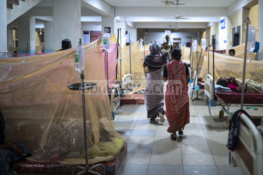 Patients with dengue fever lie inside mosquito nets in the Mugda Medical College Hospital in Dhaka on Thursday. The number of new patients has started to rise again after a drop during Eid holidays.