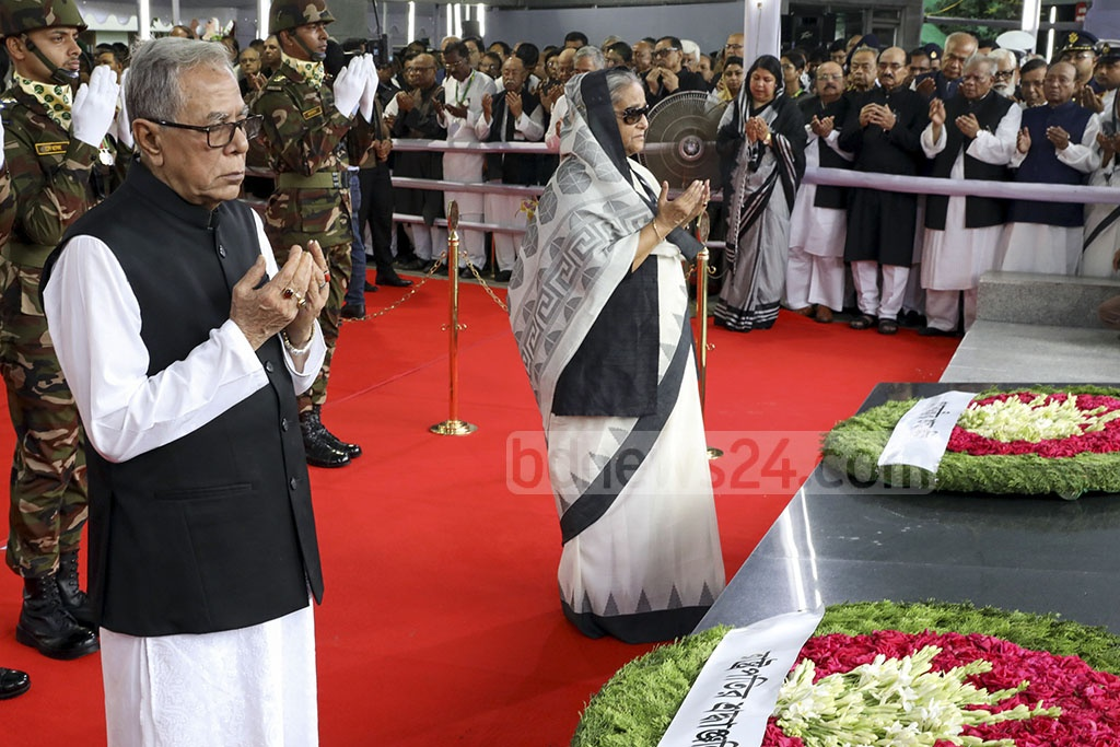 President Md Abdul Hamid and Prime Minister Sheikh Hasina pay their respects to Bangabandhu Sheikh Mujibur Rahman at Dhanmondi Road No. 32 on his 44th death anniversary on Thursday. Photo: Saiful Islam Kallol