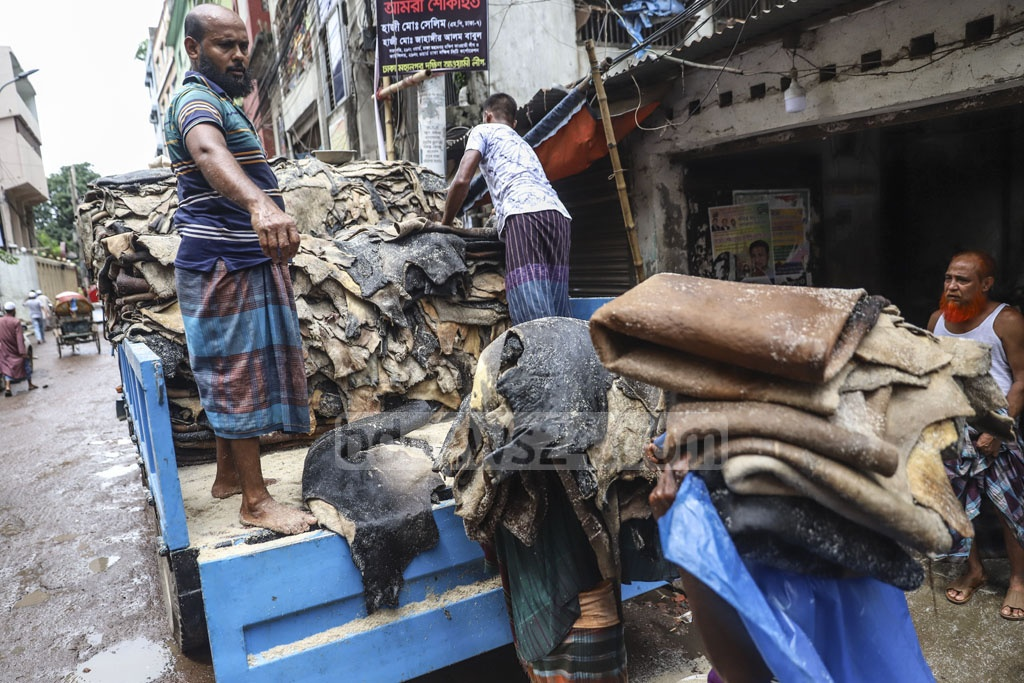 Workers in Dhaka's Posta loading a truck with rawhides after applying salt for transporting them to tanneries on Thursday. Photo: Abdullah Al Momin