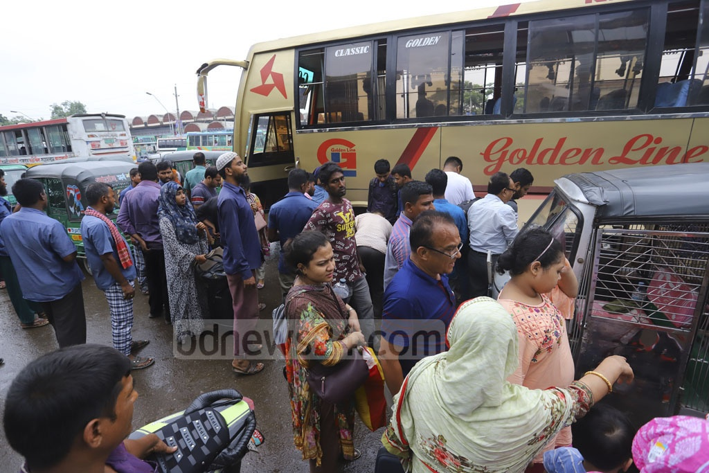 People are returning to busy days in Dhaka after spending Eid-ul-Azha holidays with their families and relatives, overcrowding Gabtoli Bus Terminal on Friday.Photo: Asif Mahmud Ove