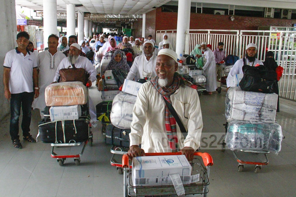 A total of 335 pilgrims return to Dhaka's Shahjalal International Airport in the first batch on Saturday after performing Hajj in Saudi Arabia.