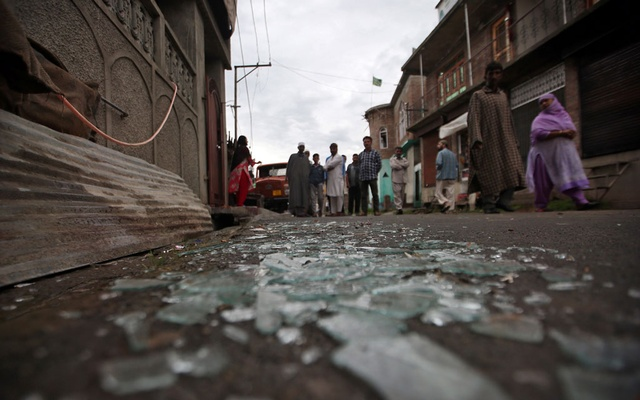 Kashmiris walk past broken window glass after clashes between protesters and the security forces on Friday evening, during restrictions following the scrapping of the special constitutional status for Kashmir by the Indian government, in Srinagar August 17, 2019. Reuters