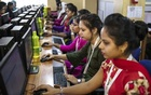 Namita Pradhan, second from right, works alongside colleagues at iMerit's technology centre in Bhubaneswar, India, Jan. 31, 2019. Tech executives rarely discuss the labour-intensive process that goes into the creation of artificial intelligence, which is learning from thousands of office workers around the world. (Rebecca Conway/The New York Times).