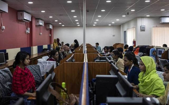 Employees at iMerit's technology centre in Kolkata, India, Jan. 30, 2019. Tech executives rarely discuss the labour-intensive process that goes into the creation of artificial intelligence, which is learning from thousands of office workers around the world. (Rebecca Conway/The New York Times).