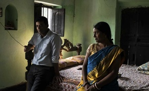 Prasenjit Baidya, left, and his wife Barnali Paik, employees of iMerit, a technology services company, at Presenjit's family home in Baidhyahat village in the state of West Bengal in India, Feb. 1, 2019. Tech executives rarely discuss the labour-intensive process that goes into the creation of artificial intelligence, which is learning from thousands of office workers around the world. (Rebecca Conway/The New York Times).