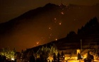Flames and smoke from a forest fire are seen in the village of Valleseco, in the Canary Island of Gran Canaria, Spain, Aug 17, 2019. REUTERS/Borja Suarez