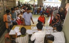 Relatives waiting in long queues for results of tests on patients, mostly with dengue fever, at the Shaheed Suhrawardy Medical College Hospital in Dhaka on Sunday. Photo: Asif Mahmud Ove