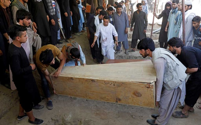 Men carry a coffin as they take part in a burial ceremony of the victims of a suicide bomb blast at a wedding in Kabul. REUTERS