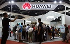 FILE PHOTO: People look at products at the Huawei stall at the International Consumer Electronics Expo in Beijing, China August 2, 2019. REUTERS/Thomas Peter