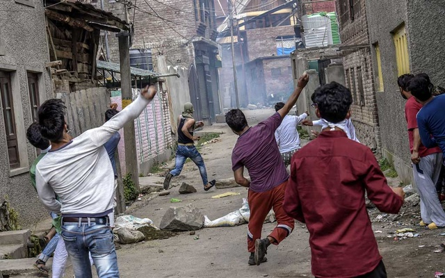 Demonstrators throw stones at police during a protest, which turned violent after police fired tear gas at protesters, on the outskirts of Srinagar in the Indian state of Kashmir, on Aug 16, 2019. More than four million people in India, mostly Muslims, are at risk of being declared foreign migrants as the government pushes a hard-line Hindu nationalist agenda that has challenged the country's pluralist traditions and aims to redefine what it means to be Indian. The New York Times