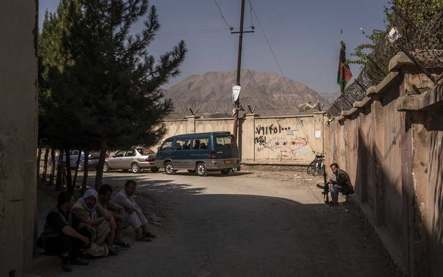 Armed men dot the narrow lane leading to a mosque near where the family of the bride, whose wedding was bombed Saturday, lives in Kabul, Afghanistan, Aug 18, 2019. In Afghanistan's protracted war, weddings were one place of celebration without guilt. On Saturday, a bomber destroyed that exception. The New York Times