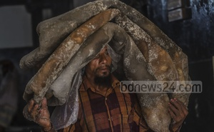 A worker hauling rawhides preserved with salt to a truck from a warehouse in Old Dhaka's Posta on Monday morning. Photo: Abdullah Al Momin