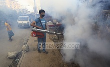 A city corporation employee spraying insecticide with a fogger machine to exterminate dengue-carrying Aedes mosquitoes in Mirpur's Paribagh on Friday amid a massive outbreak of the disease. Photo: Asif Mahmud Ove