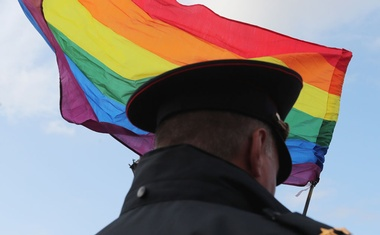 A law enforcement officer stands guard during the LGBT community rally