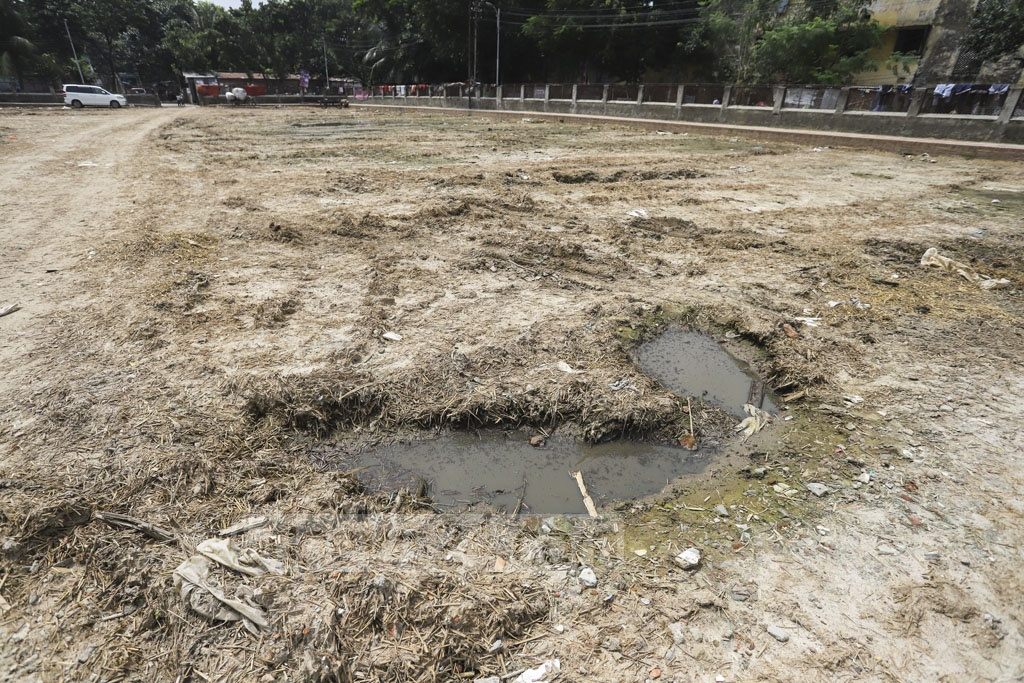 Stagnant water in big holes created on a playground at Shahjahanpur Railway Colony in Dhaka when it was turned into a cattle market before Eid-ul-Azha has become bleeding grounds of mosquitoes amid a massive dengue outbreak across Bangladesh. Photo: Asif Mahmud Ove