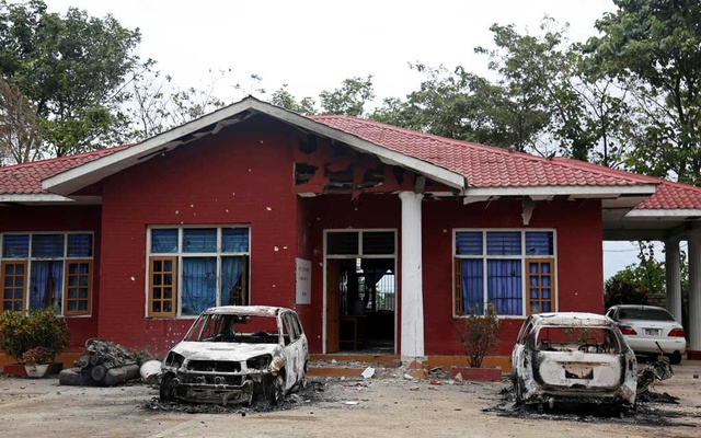 File Photo: Burned vehicles stand in front of a destroyed narcotic police office in an insurgent attack on the Myanmar-China major trading route in Nawnghkio township, Shan state, Myanmar Aug 15, 2019. REUTERS