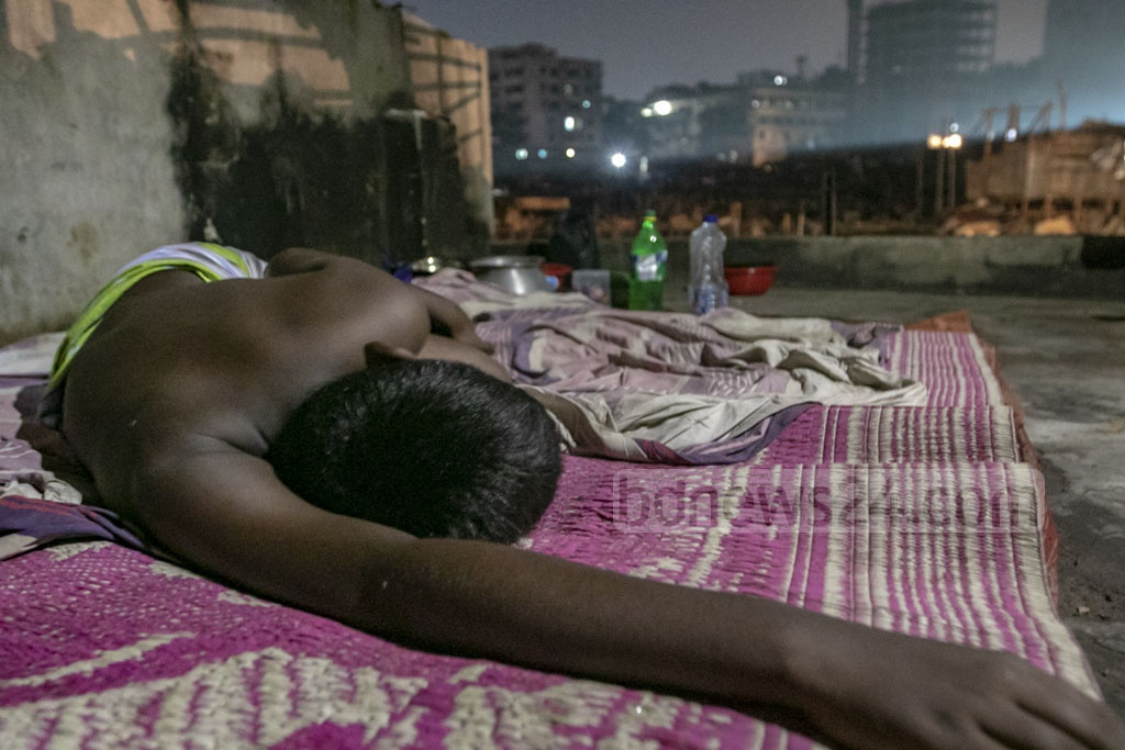 A boy is sleeping under the open sky after a fire destroyed his shanty along with hundred others on Friday. Photo: Mahmud Zaman Ovi