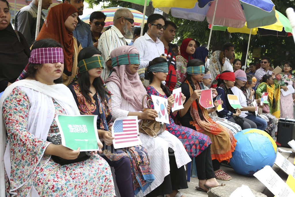 Activists of Youth Climate Network holding a sit-in programme in front of the Dhanmondi's Abahani Field on Thursday to call for effective measures against climate change.