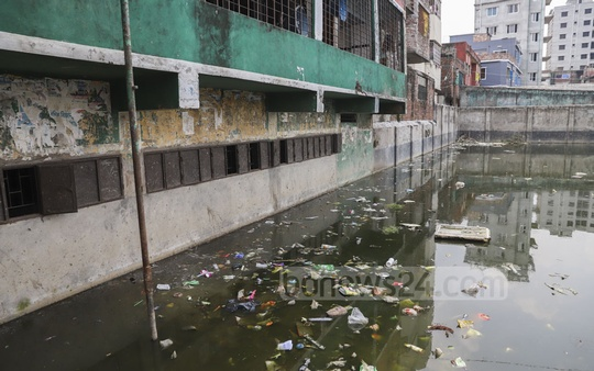Stagnant water on the Sarkar Bari's Eidgah ground almost touches the windows of Muradpur Adarsha High School. Mosquitoes breed in the filthy water. Photo: Abdullah Al Momin