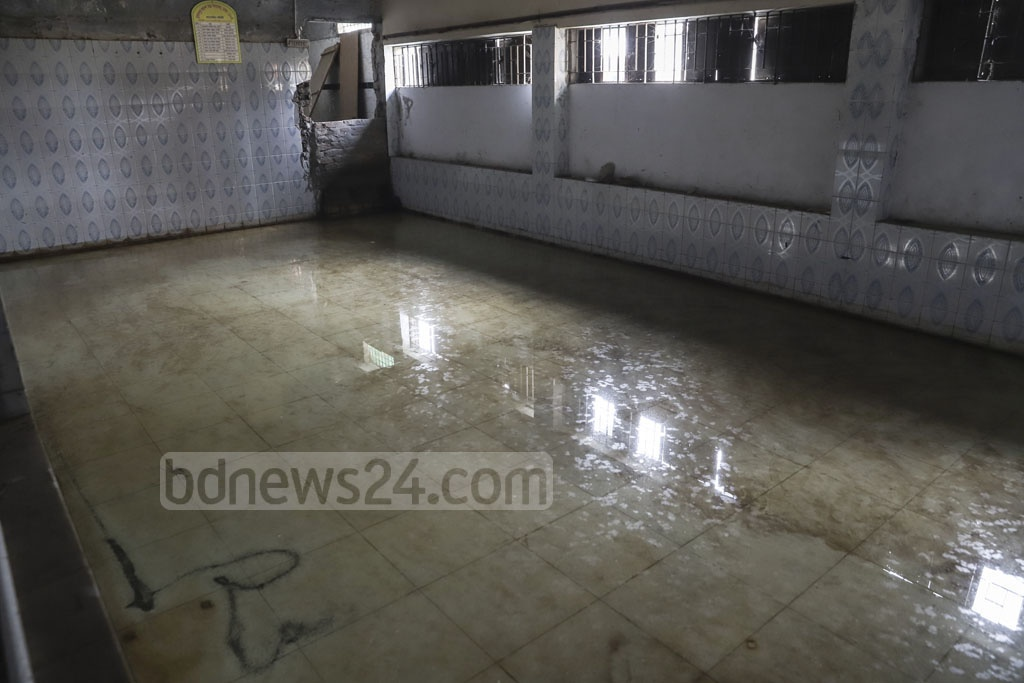 Water coming from the Muradpur Sarkar Bari's Eidgah ground enters inside the school. Photo: Abdullah Al Momin