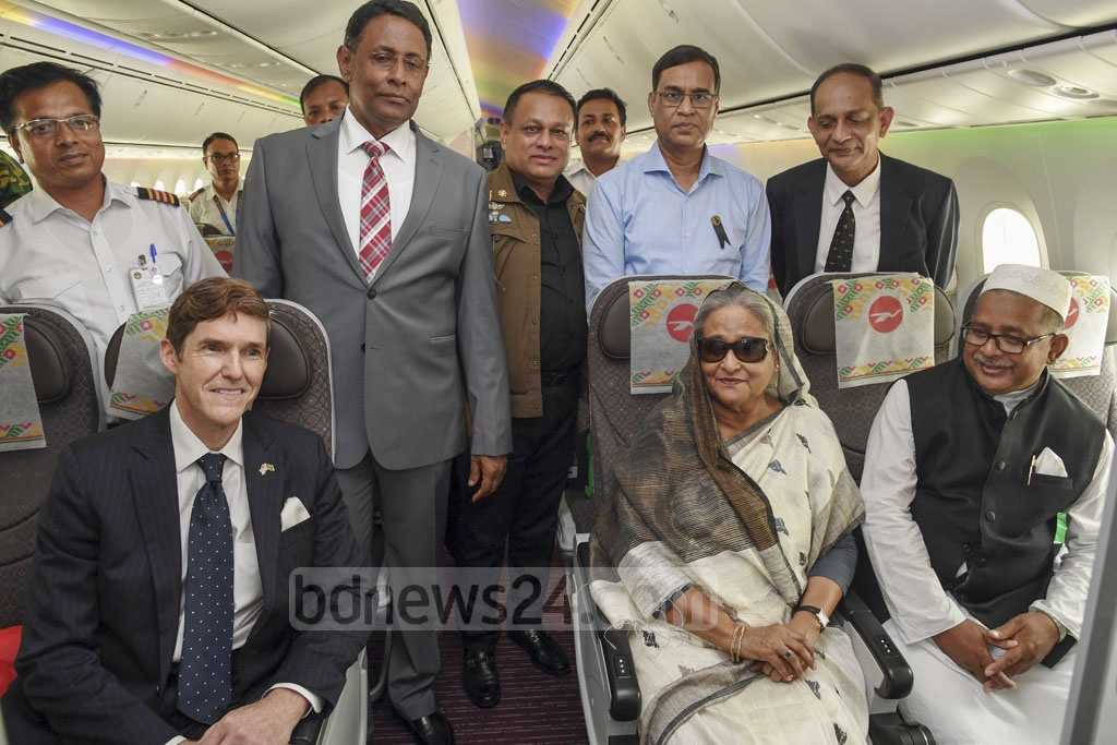 Prime Minister Sheikh Hasina sits in an economy class seat of Biman's newly-inaugurated Boeing 787-8 Dreamliner, 'Gaangchil'. Photo: PID