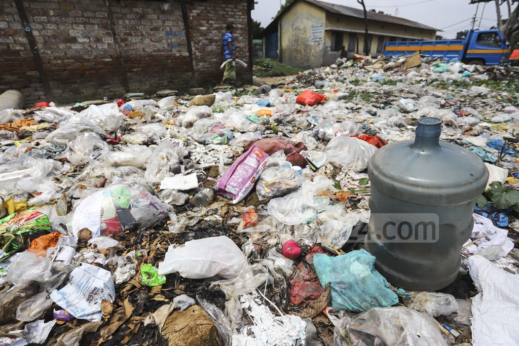 Broken plastic containers like water jars among garbage dumped on a field near Tejgaon Railway Station can easily become breeding grounds of Aedes aegypti mosquitoes, the carrier of dengue virus. This photo was clicked on Thursday amid an outbreak of the viral fever. Photo: Asif Mahmud Ove