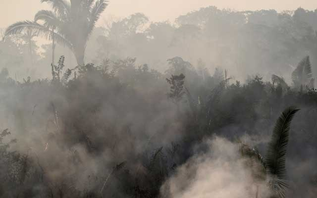 Smoke billows during a fire in an area of the Amazon rainforest near Humaita, Amazonas State, Brazil, Brazil August 14, 2019. Picture Taken August 14, 2019. REUTERS