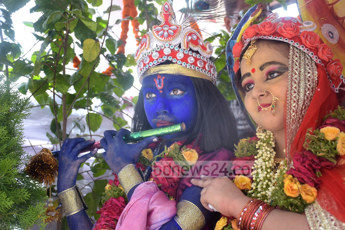 A couple dressed up as Krishna and his principal consort Radha at a parade taken out in Chittagong on Friday. Photo: Suman Babu