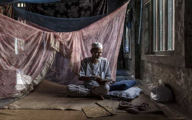 A Rohingya Muslim reads from the Quran in one of the few undamaged mosques in Maungdaw, Myanmar, May 29, 2019. The New York Times.
