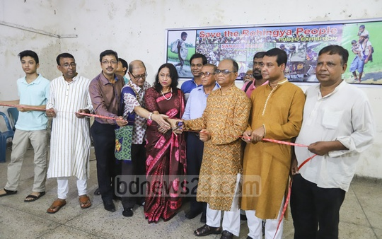 Guests inaugurate a photo exhibition on the Rohingya crisis by journalist Sanaul Haque at the National Press Club in Dhaka on Friday. Photo: Asif Mahmud Ove
