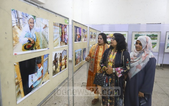 Visitors looking around the photo exhibition on the Rohingya crisis by journalist Sanaul Haque at the National Press Club in Dhaka on Friday. Photo: Asif Mahmud Ove