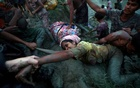 FILE PHOTO: Photographers help a Rohingya refugee to come out of Nad River as they cross the Myanmar-Bangladesh border in Palong Khali, near Cox's Bazar, Bangladesh, November 1, 2017. Reuters