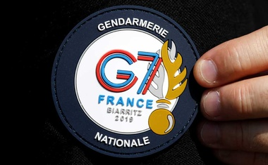 A G7 Summit patch is seen on a French Gendarme's uniform as he patrols at a toll station in Anglet ahead of the G7 Summit in the French coastal resort of Biarritz. REUTERS