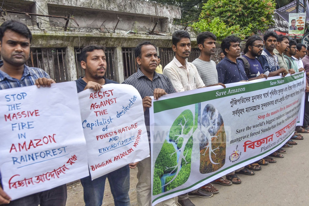 Platform of Science Movement organises a human-chain programme outside the National Press Club in Dhaka on Saturday calling for an end to 'capitalist destruction of forests, nature and environment' in the wake of fires engulfing the Amazon.