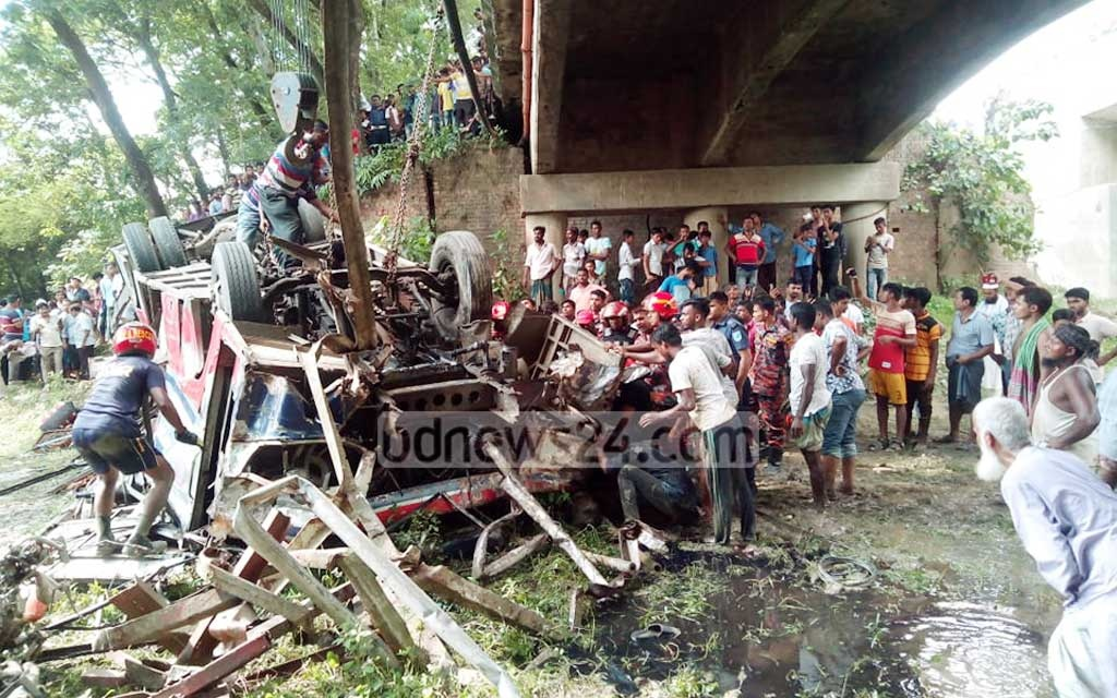 A bus crushes after falling into a ditch from a bridge on the Dhaka-Faridpur Highway in Faridpur's Dhulodi, killing at least eight people and injuring 20 others on Saturday.