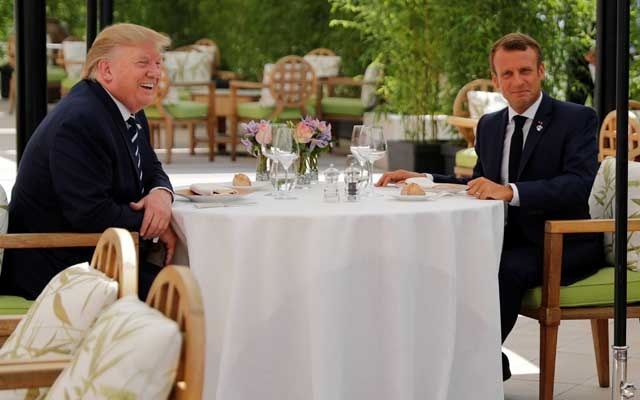 US President Donald Trump and French President Emmanuel Macron attend a lunch ahead of the G7 summit in Biarritz, France August 24, 2019. Reuters