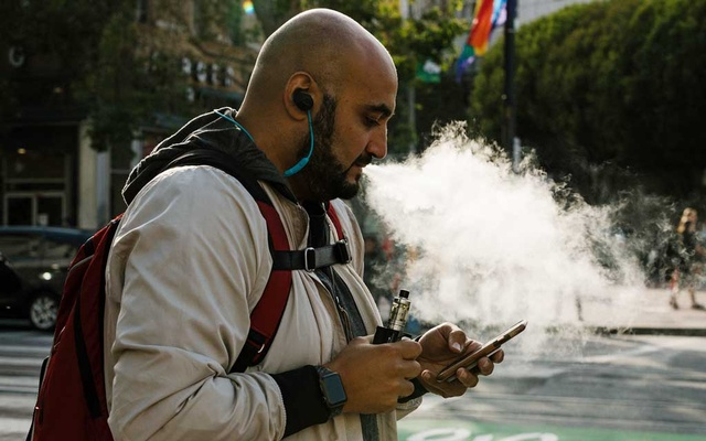 FILE Photo: A man uses a vaporiser in San Francisco, Calif, Jun 20, 2019. A person in Illinois has died from a mysterious lung illness apparently associated with an unknown vaping product, public health officials said in August. The New York Times