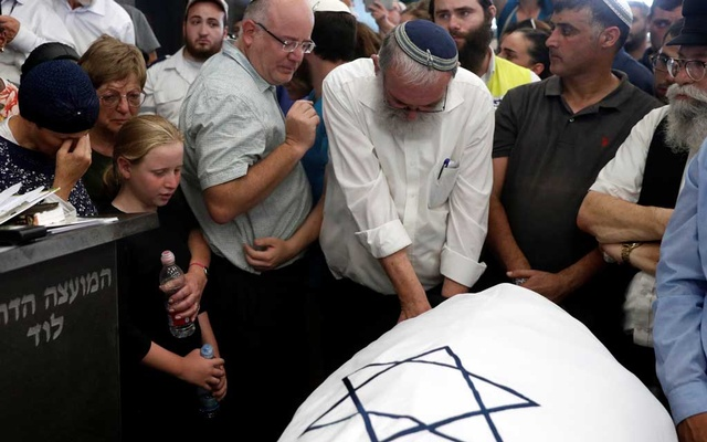 Friends and relatives mourn during the funeral of Rina Shenrav who was killed earlier today by a Palestinian bomb near a settlement in the occupied West Bank, in the city of Lod, Israel August 23, 2019 REUTERS