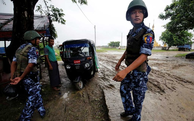 Myanmar police officer stands guard in Maungdaw, Rakhine July 9, 2019. Reuters