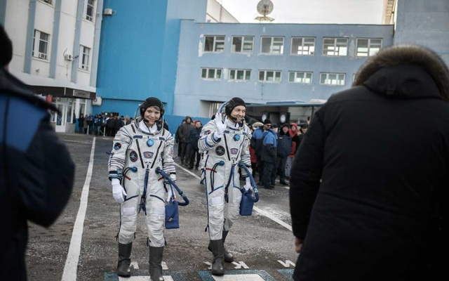 The crew of Soyuz MS-11, including flight engineer Ann McClain of NASA, left, and commander Oleg Kononenko of Roscosmos, en route to the launch pad at the cosmodrome in Baikonur, Kazakhstan on Dec 3, 2018. The New York Times