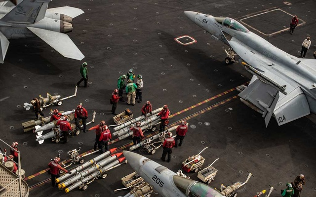 Ordnance handlers move air-to-air and air-to-ground munitions to F/A-18 Super Hornets on the flight deck of the USS Abraham Lincoln, an aircraft carrier, in the North Arabian Sea, on Aug. 10, 2019. The Navy has carried out the order of its commander in chief to counter Iran in the Middle East, but in the least provocative way.